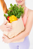 Slim woman holding bag with healthy food Royalty Free Stock Images
