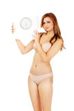 Slim woman holding a scale Stock Photography