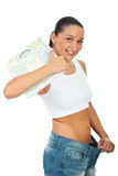 Slim woman holding scales Royalty Free Stock Photos