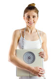 Slim woman holding scales and measuring tape Stock Photos