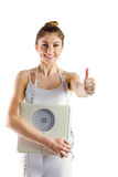 Slim woman holding scales and measuring tape Stock Images