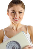 Slim woman holding weighing scales Stock Image