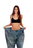 Slim woman with huge pants Royalty Free Stock Photos
