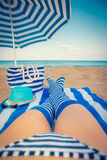 Slim woman legs on a beach Stock Images