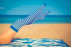 Slim woman legs on a beach Royalty Free Stock Images