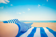 Slim woman legs on a beach Royalty Free Stock Photos