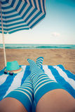 Slim woman legs on a beach Stock Image