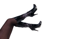 Slim woman legs in leather boots Stock Photo