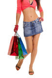 Slim woman legs with shopping bags Stock Photos