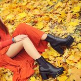 Slim woman legs with tractor sole shoes, autumn fashion concept. Outdoor in autumn park stock photo
