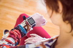 Slim woman looking at her smart watch Royalty Free Stock Photos