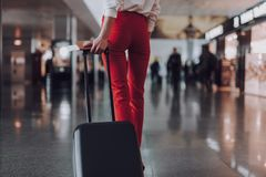 Slim woman with luggage and documents in airport stock images
