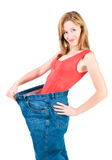 A slim woman makes good diet. A slim young woman makes good diet Royalty Free Stock Photo