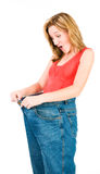 A slim woman makes good diet Royalty Free Stock Photography