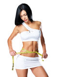 Slim  woman and measure tape Royalty Free Stock Images