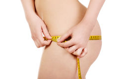 Slim woman measuring her hips. Royalty Free Stock Photos