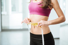 Slim woman measuring her thin waist Stock Photography