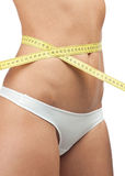Slim woman measuring her waist Royalty Free Stock Photos
