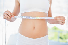 Slim woman measuring her waist Stock Images