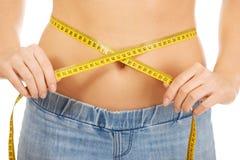 Slim woman measuring her waist. Royalty Free Stock Photos