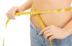 Slim woman measuring her waist. Stock Photo
