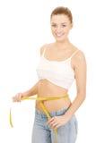 Slim woman measuring her waist. Royalty Free Stock Photo