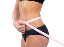 Slim woman measuring her waist metric tape measure Stock Photos