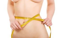 Slim woman measuring her waist. Stock Photos