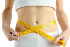 Slim woman measuring her waist Stock Photos