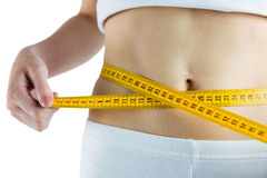 Slim woman measuring her waist Royalty Free Stock Image