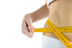 Slim woman measuring her waist Stock Photos
