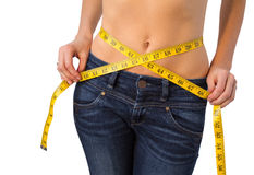 Slim woman measuring her waist Royalty Free Stock Photography
