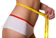 Slim woman measuring tape on belly stock photography