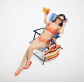 Slim woman in orange bikini Stock Images