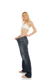 Slim woman in oversized big pants lost weight Royalty Free Stock Photo