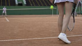 Slim woman playing tennis with professional male player, active lifestyle, sport. Stock footage stock footage