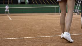 Slim woman playing tennis with professional male player, active lifestyle, sport. Slim women playing tennis with professional male player, active lifestyle stock photo