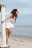 Slim woman pose by the sea wearing mini skirt and bra Royalty Free Stock Photos