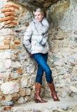 Slim woman posing in brick niche Royalty Free Stock Image