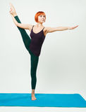 Slim woman practicing yoga asana Royalty Free Stock Photo