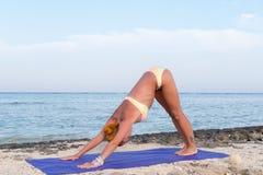 Slim woman practicing yoga stock photos