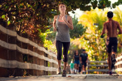 Slim woman running Royalty Free Stock Photo