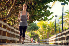 Slim woman running Royalty Free Stock Images