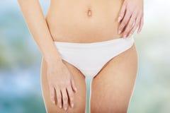 Slim woman's belly. Stock Photos