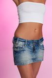 Slim woman's  torso on pink background Royalty Free Stock Image