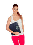 Slim woman with a scale in his arms Stock Photo