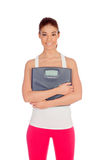 Slim woman with a scale in his arms Stock Image