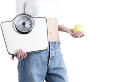 Slim woman with scales Stock Photos