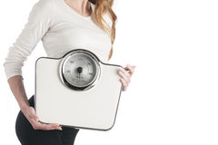 Slim woman with scales Stock Photo