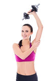 Slim woman in sports wear doing exercises with dumbbells isolate Royalty Free Stock Photo